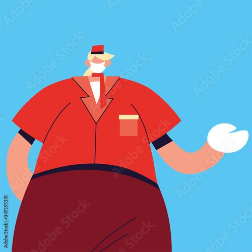 Fototapeta man waiter with face mask and uniform obraz