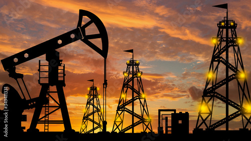 Silhouette of an oil production company. Natural resource extraction. Oil rigs against the evening sky. Oil export. Fuel industry. Global energy market.