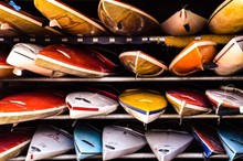 Colorful Canoes Arranged On Shelf In Storage Room