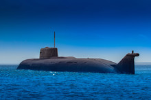 Submarine Close-up. Nuclear Submarine On A Background Of Blue Water And Blue Sky. Protection Of The State's Water Borders. Navy. Fleet. Fighting On The Water. Intelligence Operation.