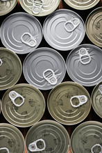 Various Tuna Cans In Gold And Silver Color From A Top View