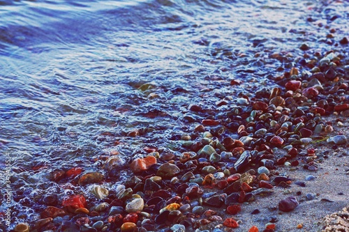 Photo Sea Wave Washing Ashore Covered In Pebbles