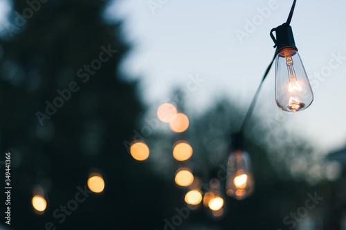 Close-up Of Illuminated Light Bulb Against Sky Fototapete
