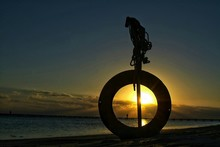 Silhouette Lifebelt At Beach During Sunset