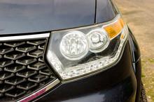 Front Headlight Dark Blue Car Close Up