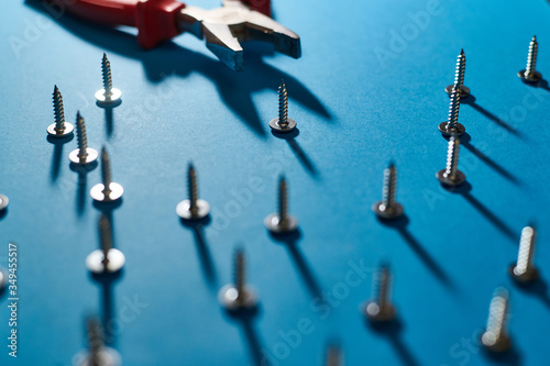 Screws and pliers on a blue background. Wallpaper Mural