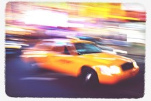 Blurred View Of Yellow Taxi
