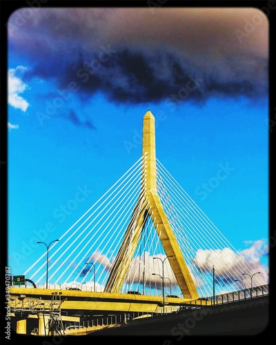 Photo Low Angle View Of Leonard P Zakim Bunker Hill Memorial Bridge Against Blue Sky