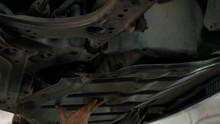 Mechanic Screwing Car Gear Bol...