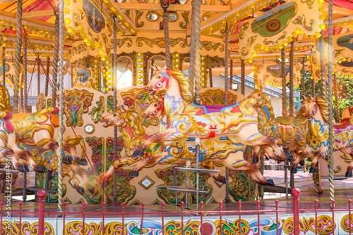 Valokuva Close-up of a colorful carousel with horses to make a merry go round ride
