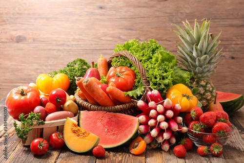 Leinwand Poster assorted of fruit and vegetable on wood background