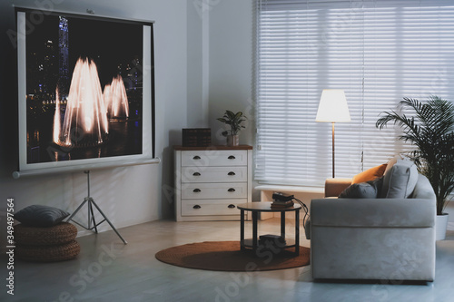 Canvas Print Stylish room with modern video projector and comfortable sofa