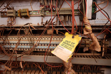 Safe Workplace Yellow Out Of Service Tag Placing On Industrial Electricity Wire Cord As Faulty Damage Equipment Dangerous To Used Remove Out From Services