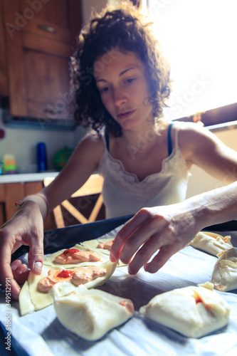 Young woman cooking at home #349512991