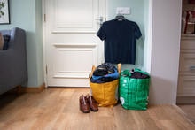 A Bag Of Clothes And Items Wai...