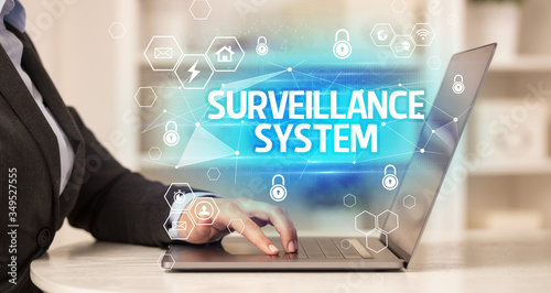 Fototapety, obrazy: SURVEILLANCE SYSTEM inscription on laptop, internet security and data protection concept, blockchain and cybersecurity