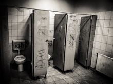 Interior Of Abandoned Public Bathroom