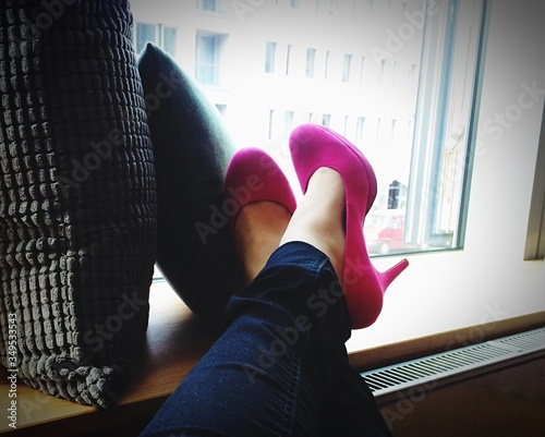 Low Section Of Woman In Pink High Heels At Home Fototapet