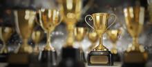 Golden Trophy Award On Dark Ba...