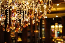 Close-up Of Illuminated Chandelier Hanging At Night