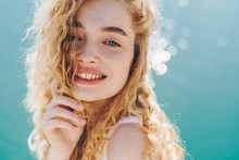 Curly Blonde Smiling Broadly W...