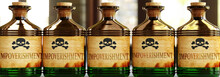 Impoverishment Can Be Like A Deadly Poison - Pictured As Word Impoverishment On Toxic Bottles To Symbolize That Impoverishment Can Be Unhealthy For Body And Mind, 3d Illustration