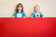 canvas print picture - Superheroes children holding red banner blank