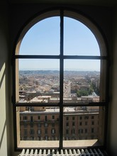 Cityscape Against Clear Sky Seen Through Arch Window