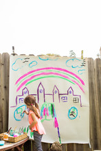 A Young Girl Painting A Castle...