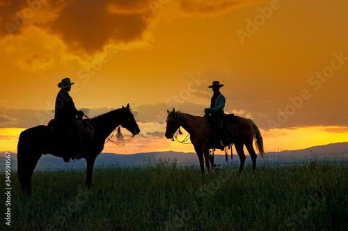 Cowboys on horseback Canvas Print