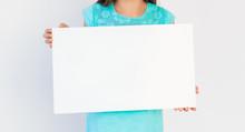 Girl Holding Blank Sheet Of Pa...