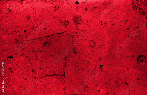 Red grunge background. Cracked stone wall texture. Canvas Print