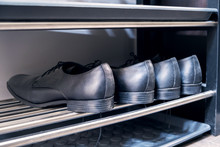 Shelving Rack With Shoes In Hallway Indoors