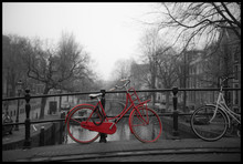 Red Bicycle On Bridge Over River In City During Winter