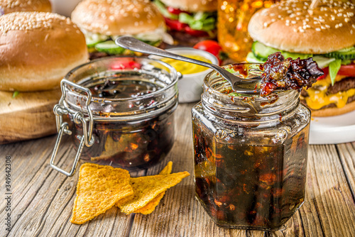 Fototapeta Homemade bacon jam in jars, with bread and burgers obraz