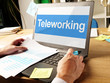 Teleworking is shown on the conceptual business photo