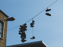 Sneakers And Shoes On A Wire