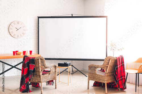 Photo Interior of room with video projector