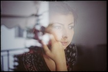 View Of Woman Through Window