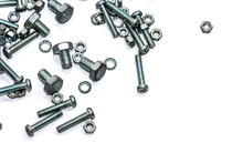 Close-up Of Nuts And Bolts On White Background