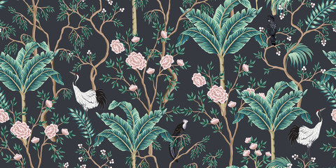 Fototapeta Drzewa Vintage garden tree, banana tree, birds, crane floral seamless pattern black background. Exotic chinoiserie wallpaper.