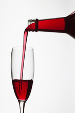 Close-up Of Red Wine Against White Background