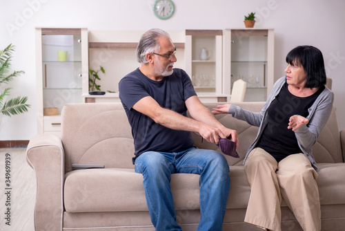Old couple having argument at home Canvas Print