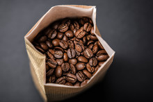 High Angle View Of Roasted Coffee Beans In Bag On Table