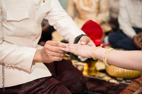 Bride And Groom Exchanging Rings In Front Of People During Wedding Fotobehang