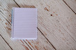 High Angle View Of Blank Spiral Notebook On Wooden Table