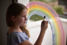 Girl Painting Rainbow During C...