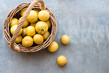 High Angle View Of Lemons In Basket On Table