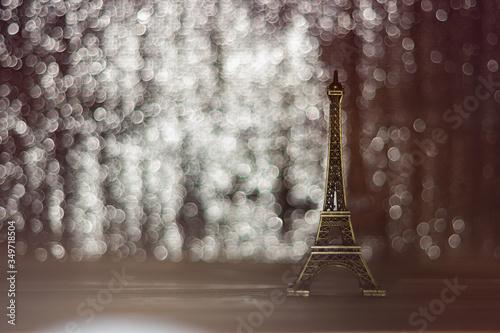 Fototapeta Close-up View Of Eiffel Tower Figurine On Table