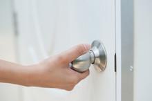 Close-up Of Hand Opening Door